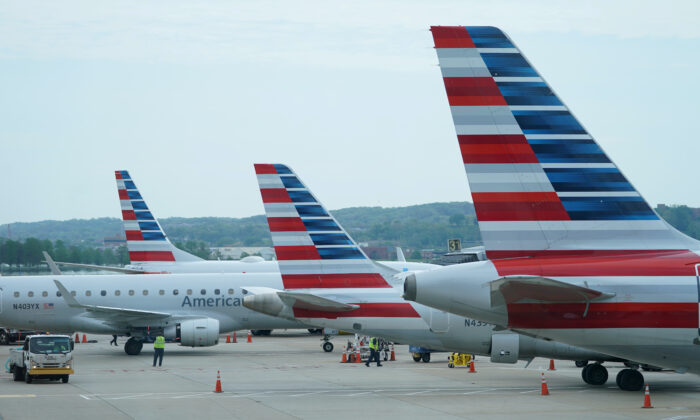 American Airlines jets made by Embraer and other manufacturers sit at gates at Washington's Reagan National Airport amid the coronavirus pandemic, in Washington on April 29, 2020. (Kevin Lamarque/Reuters)