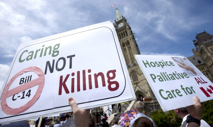 People rally against Bill C-14, the medically assisted dying bill, during a protest organized by the Euthanasia Prevention Coalition on Parliament Hill in Ottawa, Canada, on June 1, 2016. (Justin Tang/The Canadian Press