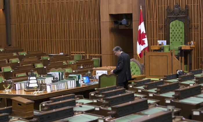 A House of Commons clerk prepares for a committee meeting in the chamber on April 29, 2020. (The Canadian Press/Adrian Wyld)