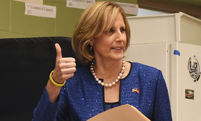 Republican congressional candidate Claudia Tenney signals she successfully cast her ballot after voting at St. George's Church in New Hartford, N.Y. on Dec. 1, 2020. (Heather Ainsworth/AP Photo)