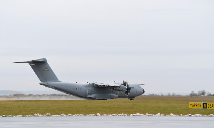 An A400M military transport plane carrying doctors, nurses, and hygiene experts as well as mobile and stationary ventilators takes off to COVID-19 stricken Portugal, in Wunstorf, Germany, on Feb. 3, 2021. (Fabian Bimmer/Reuters)