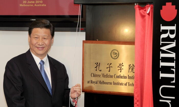 Then-Chinese vice chair Xi Jinping unveils a plaque at the opening of Australia's first Chinese Medicine Confucius Institute at the RMIT University in Melbourne on June 20, 2010. (William West/AFP via Getty Images)