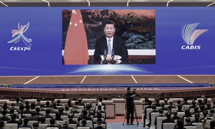Chinese leader Xi Jinping delivers a speech via video at the opening ceremony of the China-ASEAN Business and Investment Summit, in Nanning, in southern Guangxi, China, on Nov. 27, 2020. (STR/AFP via Getty Images)