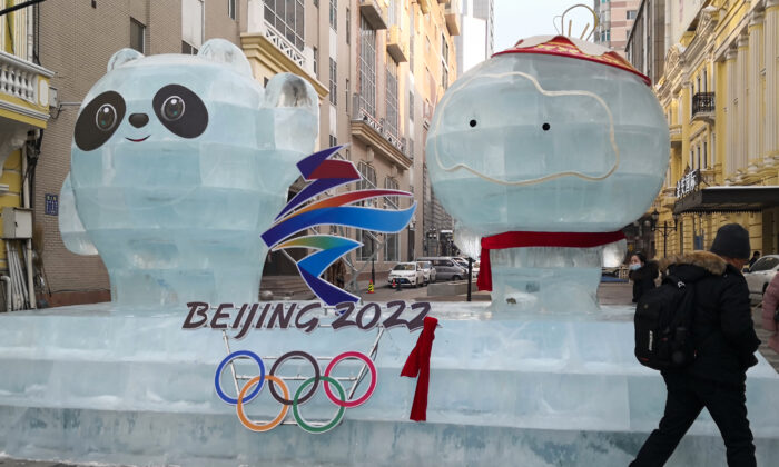 An ice sculpture of mascots for the 2022 Beijing Winter Olympics and Paralympic Games on a street in Harbin, a city in northeastern China's Heilongjiang Province, on Dec. 28, 2020. (STR/AFP via Getty Images)