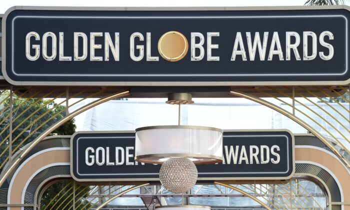 Event signage appears above the red carpet at the 77th annual Golden Globe Awards in Beverly Hills, Calif., on Jan. 5, 2020. (Jordan Strauss/Invision/AP)