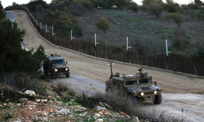 Israeli military vehicles near the kibbutz Manara in northern Israel's upper Galilee patrol along the border with Lebanon, on Dec. 20, 2020. (Jalaa Marey/AFP via Getty Images)