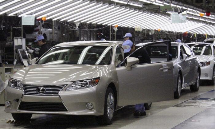 Toyota workers inspect the new Lexus ES vehicles at a Toyota plant in Miyawaka, southern Japan, on July 6, 2012. (Yoko Kubota/File Photo/Reuters)