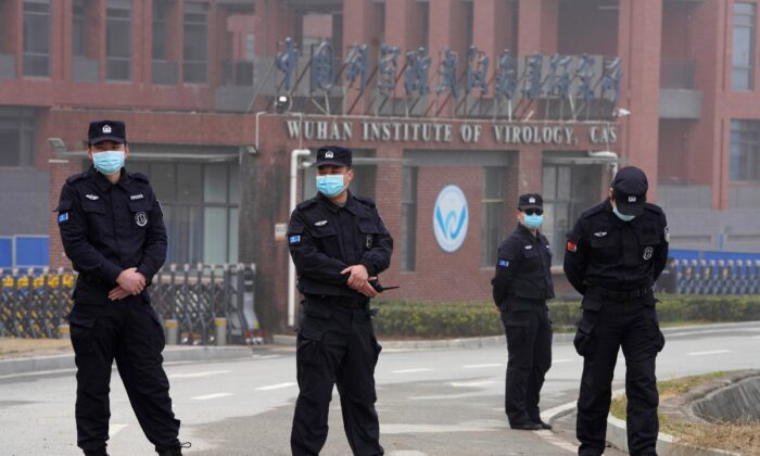 Security personnel gather near the entrance of the Wuhan Institute of Virology during a visit by the World Health Organization team in Wuhan in China's Hubei province, China, on Feb. 3, 2021. (Ng Han Guan/AP Photo)