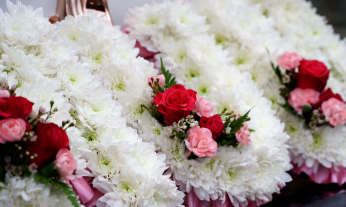 Flowers at a funeral at T Cribb & Sons funeral home in London on Jan. 31, 2021. (NTD/Screenshot)