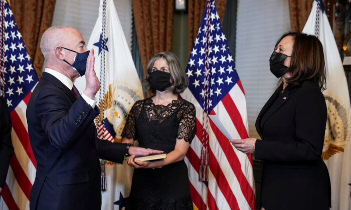 Vice President Kamala Harris holds a ceremonial swearing-in for Department of Homeland Security Secretary Alejandro Mayorkas as his wife Tanya holds a Union Prayer Book at the White House in Washingto on Feb. 2, 2021. (Kevin Lamarque/Reuters)