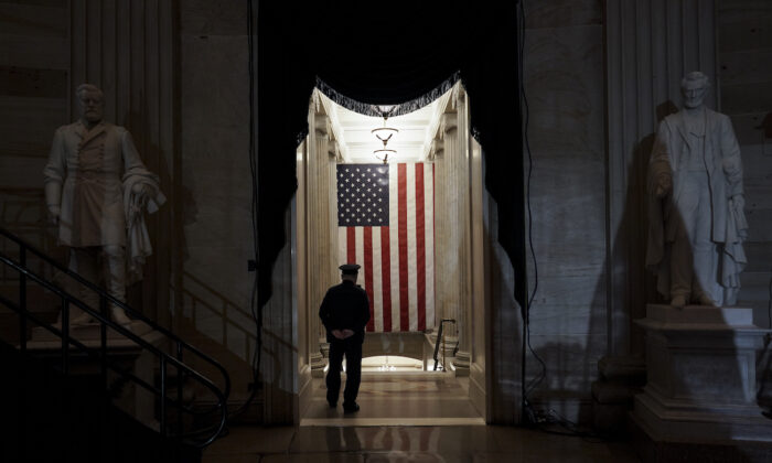 A U.S. Capitol Police officer stands at the door of the Capitol Rotunda near where the late U.S. Capitol Police officer Brian Sicknick will lie in honor in Washington, Feb. 2, 2021. (Salwan Georges/The Washington Post via AP, Pool)