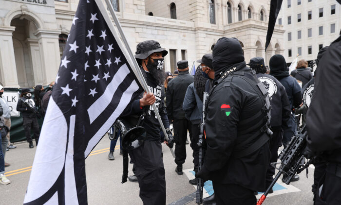 Members of the Black Panthers join other gun rights advocates in front of the Virginia State House during a rally, in Richmond, Va., on Jan. 18, 2021. (Spencer Platt/Getty Images)