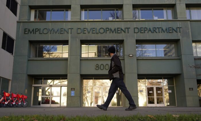 A person passes the office of the California Employment Development Department in Sacramento, Calif., on Dec. 18, 2020. (Rich Pedroncelli/AP Photo)