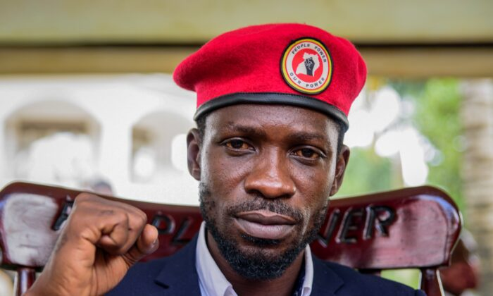 Ppposition presidential challenger Bobi Wine, whose real name is Kyagulanyi Ssentamu, gestures as he speaks to the media outside his house after government soldiers withdrew from it, in Magere, near Kampala, in Uganda on Jan. 26, 2021. (Nicholas Bamulanzeki/AP Photo/ File)