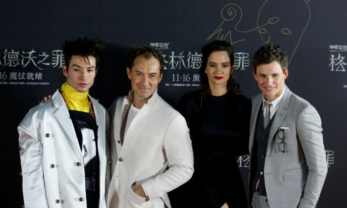 "Cast members Ezra Miller, Jude Law, Katherine Waterston and Eddie Redmayne attend a promotion for the movie ""Fantastic Beasts: The Crimes of Grindelwald"" in Beijing, China on Oct. 28, 2018. (Thomas Peter/Reuters)"