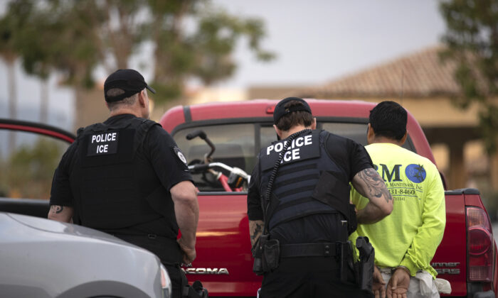 U.S. Immigration and Customs Enforcement (ICE) officers detain a man during an operation in Escondido, Calif., on July 8, 2019. (Gregory Bull/AP Photo)