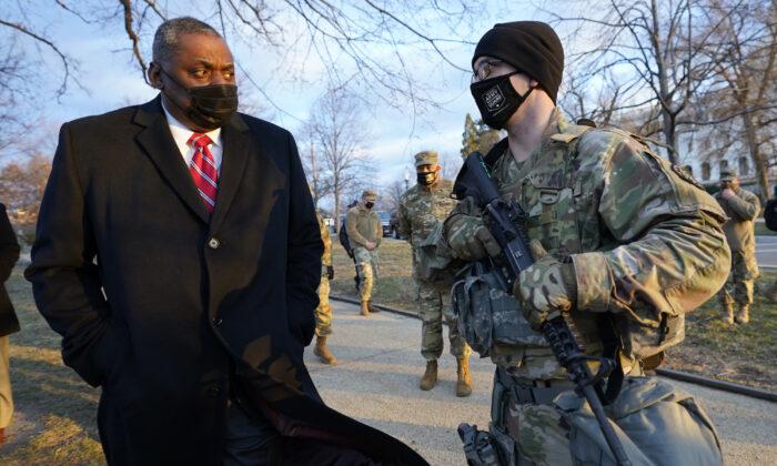 Secretary of Defense Lloyd Austin visits National Guard troops deployed at the U.S. Capitol and its perimeter, in Washington, on Jan. 29, 2021. (Manuel Balce Ceneta, Pool/AP Photo)