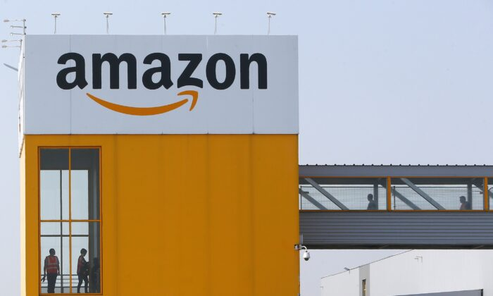 Amazon workers are seen at a facility in Douai, France on Feb. 2, 2021. (Michael Spingler/AP Photo)