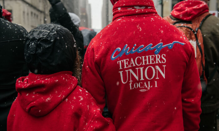 Chicago public school teachers marched through the streets near City Hall during a strike in Chicago, Ill., on Oct. 31, 2019. (Scott Heins/Getty Images)