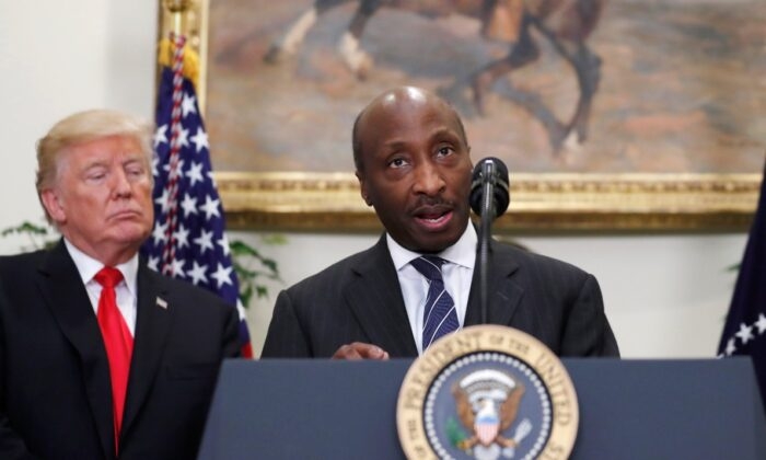 Ken Frazier, chairman and chief executive officer of Merck speaks, with President Donald Trump at (L), during an event to announce a Merck, Pfizer, and Corning joint partnership to make glass containers for medication, in the Roosevelt Room of the White House in Washington, on July 20, 2017. (Alex Brandon/File/AP Photo)