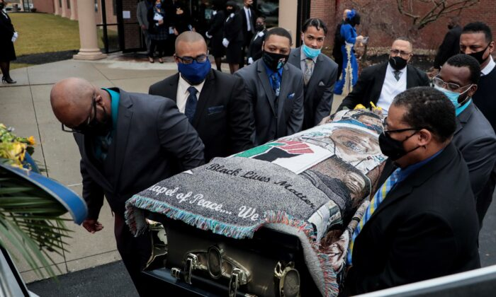 Pallbearers carry the casket of Andre Hill to a hearse following funeral services at First Church of God in Columbus, Ohio, on Jan. 5, 2021. (Joshua A. Bickel/The Columbus Dispatch via AP)