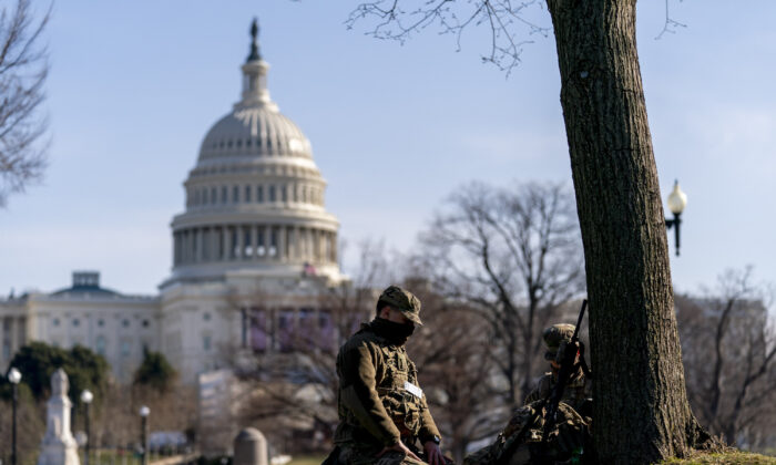 Members of the National Guard work outside the U.S Capitol building on Capitol Hill in Washington on Jan. 20, 2021. (/Andrew Harnik/AP Photo)