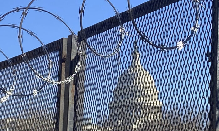 Riot fencing and razor wire reinforce the security zone on Capitol Hill, in Washington, on Jan. 23, 2021. (Eileen Putman/AP Photo)