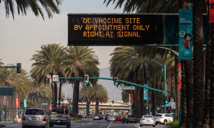 A sign communicates the arrival of a coronavirus vaccination center set up in a parking area of Disneyland themepark in Anaheim, Calif., on Jan, 13, 2021. (John Fredricks/The Epoch Times)