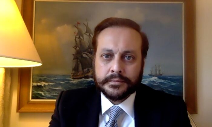 In this still image taken from a video, Imran Ahmad Khan MP speaks to NTD in a virtual interview, in London on Feb. 4, 2021. (NTD)