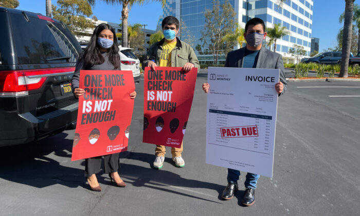 Community activists prepare to deliver petitions to Rep. Katie Porter (D-California) calling for monthly stimulus checks in Irvine, Calif., on Feb. 4, 2021. (Drew Van Voorhis/The Epoch Times)