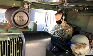 Music Teacher in National Guard Teaches Music Class From Humvee in Washington