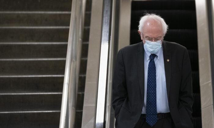 Sen. Bernie Sanders (I-Vt.) walks on Capitol Hill in Washington on Feb. 2, 2021. (Drew Angerer/Getty Images)