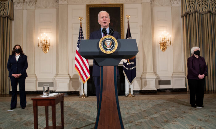 President Joe Biden speaks while flanked by Vice President Kamala Harris, left, and Treasury Secretary Janet Yellen, in the White House in Washington on Feb. 5, 2021. (Brendan Smialowski/AFP via Getty Images)