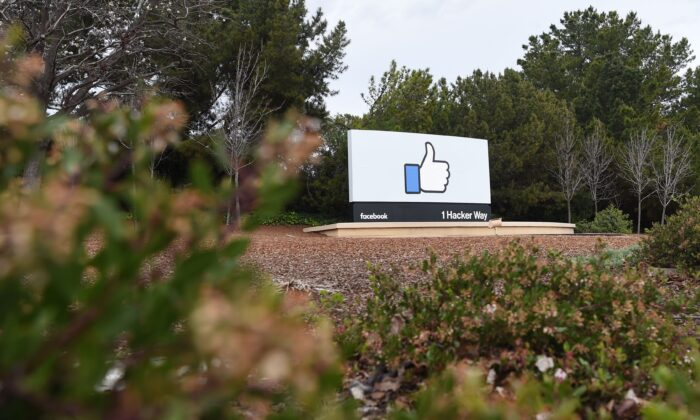 A sign is seen at the entrance to Facebook's corporate headquarters location in Menlo Park, Calif., on March 21, 2018. (Joseh Edelson/AFP via Getty Images)