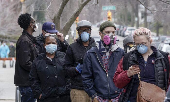 People wear masks in a file photo. (Morry Gash/AP Photo)