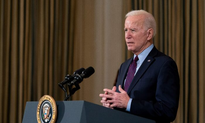 President Joe Biden delivers remarks on the national economy and the need for his administration's proposed $1.9 trillion coronavirus relief legislation in the State Dining Room at the White House in Washington, on Feb. 5, 2021. (Stefani Reynolds/Pool/Getty Images)