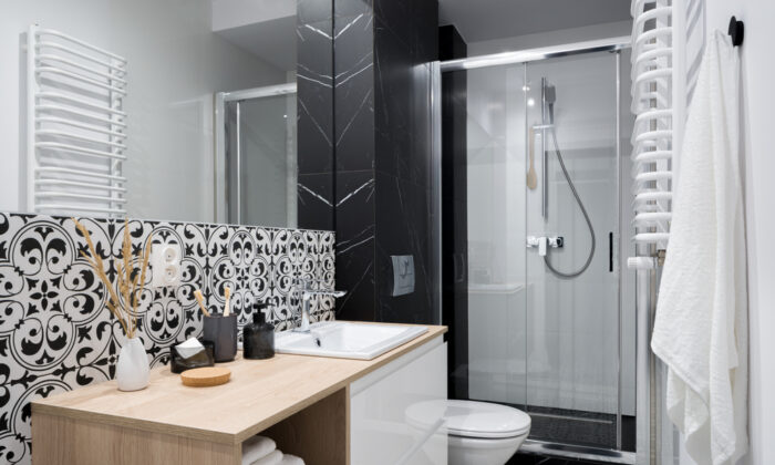Adding decorative tile or changing the existing tile pattern can dramatically enhance the entire bathroom. (Dariusz Jarzabek/Shutterstock)