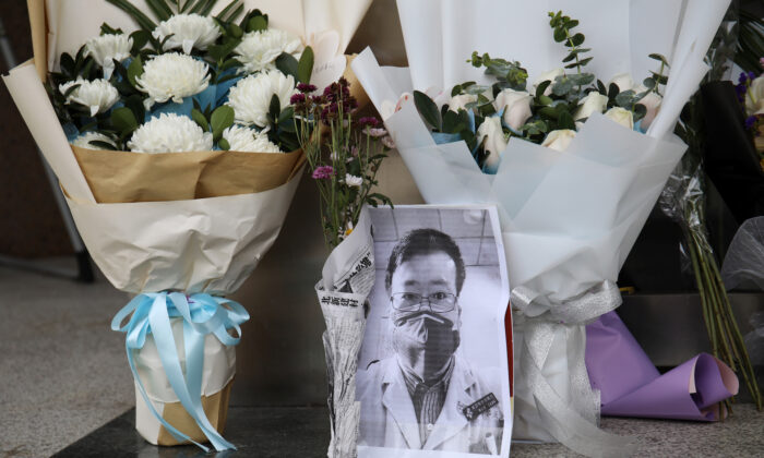 A makeshift memorial for doctor Li Wenliang at an entrance to the Central Hospital of Wuhan in Hubei province, China on Feb. 7, 2020. (Stringer/Reuters)