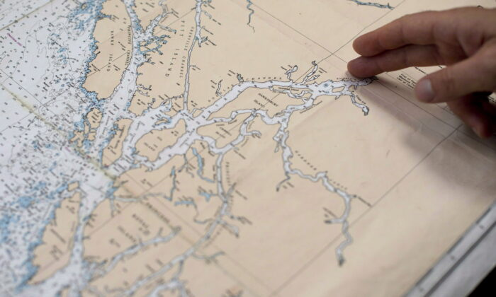 A proposed tanker route out of Kitimat, B.C., related to the Northern Gateway project is shown on a map on Sept, 19, 2013. The project was effectively cancelled after the federal government banned oil tankers from B.C.'s north coast. (The Canadian Press/Jonathan Hayward)