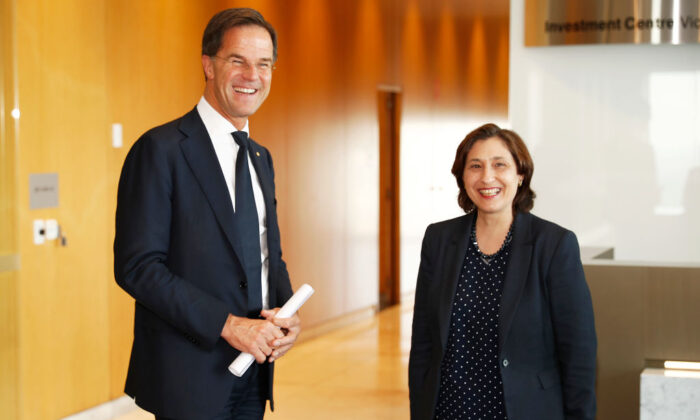 Prime Minister Mark Rutte of the Netherlands speaks with Lily D'Ambrosio, Minister for Energy, during the Forum on Circular Economy at the Investment Centre Victoria on October 11, 2019 in Melbourne, Australia. (Daniel Pockett/Getty Images)