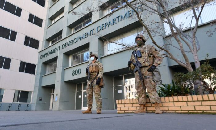 Members of the National Guard protect an Employment Development Department building near the State Capitol in Sacramento, Calif., on Jan. 17, 2021. (Josh Edelson/AFP via Getty Images)