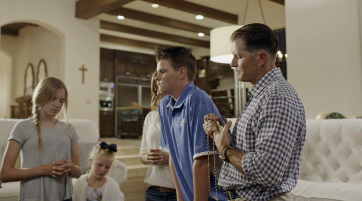"family praying together in ""Pray"""
