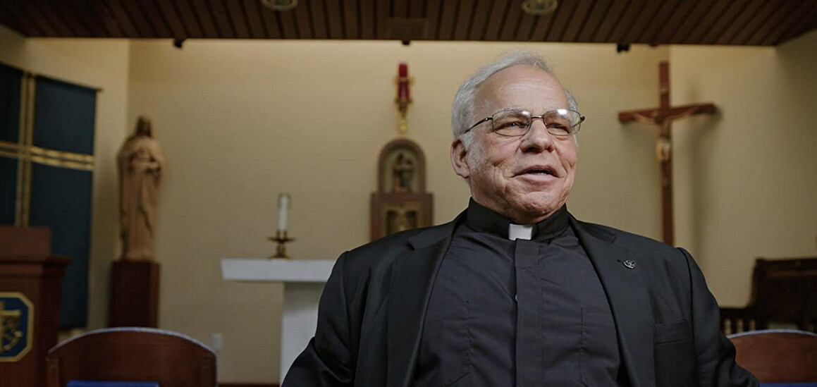 "priest in front of altar in ""Pray"""