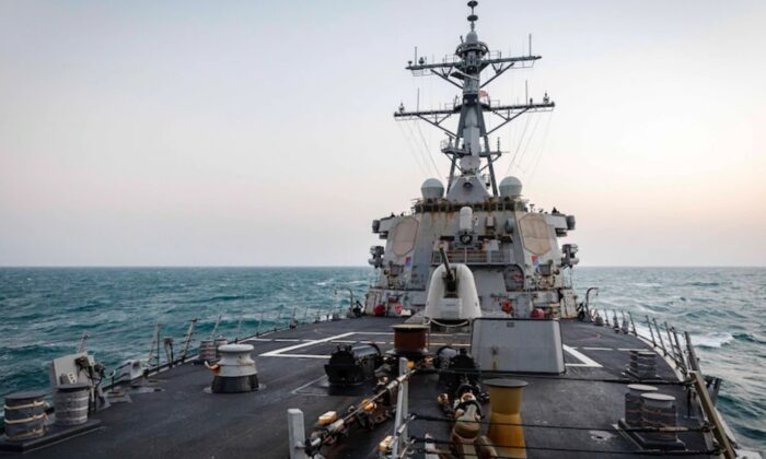 The Arleigh Burke-class guided-missile destroyer USS John S. McCain (DDG 56) transits through South China Sea while conducting routine underway operations on Feb. 5, 2021. (Mass Communication Specialist 2nd Class Markus Castaneda/U.S. 7th Fleet)