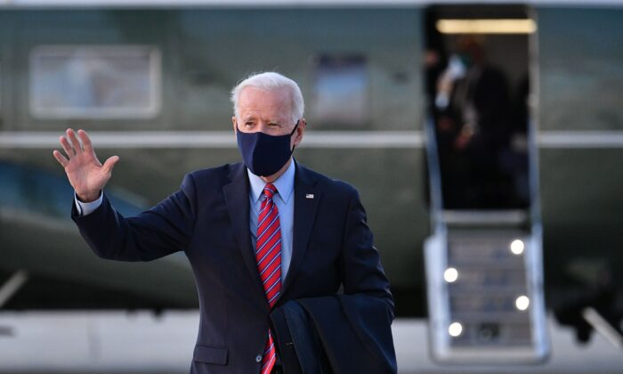 President Joe Biden waves as he makes his way to board Air Force One before departing from Andrews Air Force Base in Maryland on Feb. 5, 2021. (Mandel Ngan/AFP via Getty Images)