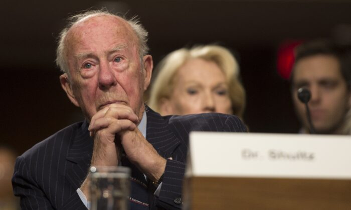 """Former Secretary of State George Shultz testifies before the U.S. Senate Armed Services Committee hearing on """"Global Challenges and the U.S. National Security Strategy"""" on Capitol Hill in Washington, on Jan. 29, 2015. (Jim Watson/AFP via Getty Images)"""