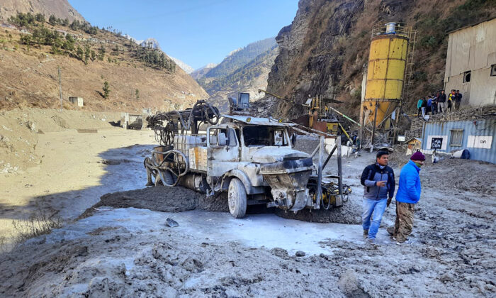 People inspect the site near the damaged Dhauliganga hydropower project at Reni village in Chamoli district after a portion of Nanda Devi glacier broke off in Tapovan area of the northern state of Uttarakhand, on Feb. 7, 2021. (AP Photo)
