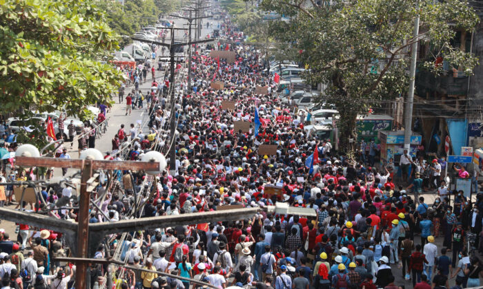 Protesters march towards the direction of Sule Pagoda in Yangon, Burma, on Feb. 7, 2021. (AP Photo)
