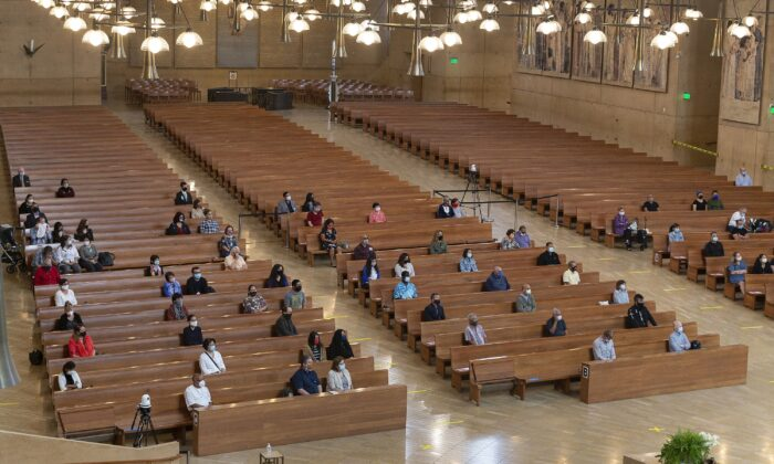 A hundred faithful sit while minding social distancing, listening to Los Angeles Archbishop Jose H. Gomez celebrate Mass at Cathedral of Our Lady of the Angels, the first Mass held in English at the site since the re-opening of churches, in downtown Los Angeles, Calif., on June 7, 2020. (Damian Dovarganes/AP Photo)