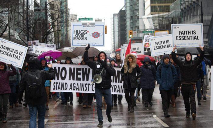 Founder of We Are All Essential Vladislav Sobolev (C) leads a march during an anti-lockdown protest in Vancouver on Dec. 27, 2020. (Courtesy of Vladislav Sobolev)